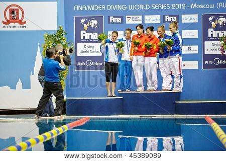 MOSCOW - APR 13:  Female athletes-medalists are pfotographed on victory podium at Pool of SC Olympic on day of third phase of the World Series of FINA Diving, April 13, 2012, Moscow, Russia.