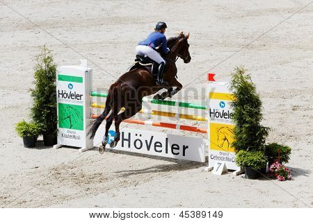 MOSCOW - JUN 9: Female participant of international competitions in show jumping CSI3 Vivat, Russia in equestrian center Bitsa, Jun 9, 2012, Moscow Russia. Prize fund of competition was 114 500 euros.