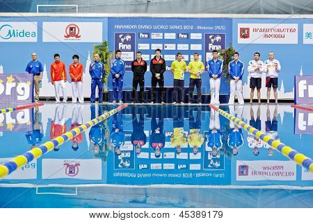 MOSCOW - APR 13: Athletes stand near to victory podium before awarding at Pool of SC Olympic on day of third phase of the World Series of FINA Diving, April 13, 2012, Moscow, Russia.