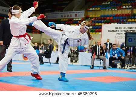 MOSCOW - JUN 9: Female fighter attacks opponent with her foot in fight at 10th Team Championship of Europe on karate at OC Luzhniki, Small sports arena, June 9, 2012, Moscow, Russia.