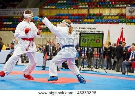 MOSCOW - JUN 9: Female fighter attacks opponent in fight at 10th Team Championship of Europe on karate at OC Luzhniki, Small sports arena, June 9, 2012, Moscow, Russia.