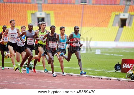 MOSCOW - JUN 11: Group of runners on race track at Grand Sports Arena of Luzhniki OC during International athletics competitions IAAF World Challenge Moscow Challenge, June 11, 2012, Moscow, Russia.