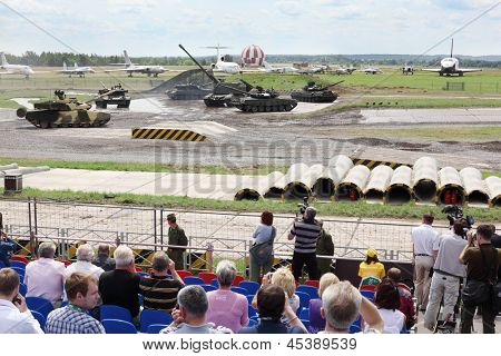 ZHUKOVSKY - JUNE 25: Spectators and dancing tanks at second International Forum Engineering Technologies 2012, on June 25, 2012 in Zhukovsky near Moscow, Russia.
