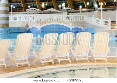 MOSCOW - JUNE 25: Seats near pool in waterpark Caribia, on June 25, 2012 in Moscow, Russia. Entertainment center Caribia is located in Eastern District of Moscow in district Perovo.