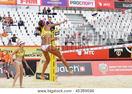 MOSCOW - JUNE 6: Two athletes from Brazil play volleyball in Country Quota at tournament Grand Slam of beach volleyball 2012, on June 6, 2012 in Moscow, Russia.