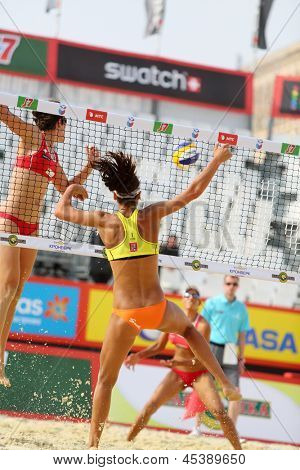 MOSCOW - JUNE 6: Female teams from USA jump in Country Quota at tournament Grand Slam of beach volleyball 2012, on June 6, 2012 in Moscow, Russia.