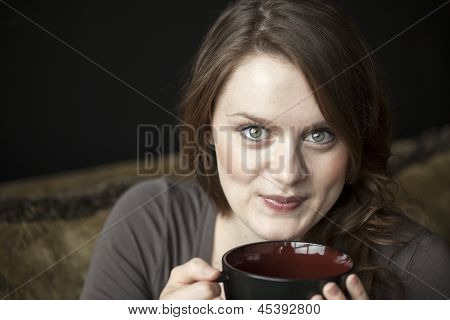 Young Woman With Beautiful Green Eyes And Black Coffee Cup