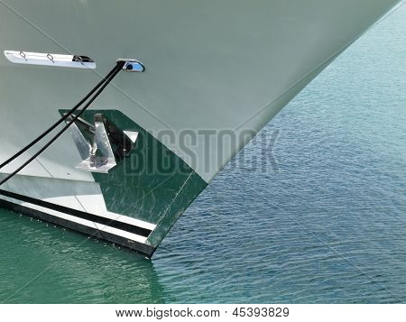 Moored ships bow with retracted anchor abstract