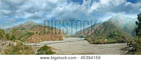 Watercourse River With Mountain Ranges. India, Uttarakhand