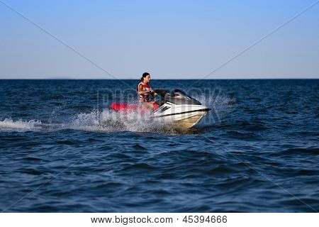 Brunette On A Jetski