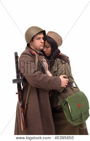 Man in military clothes hugging woman