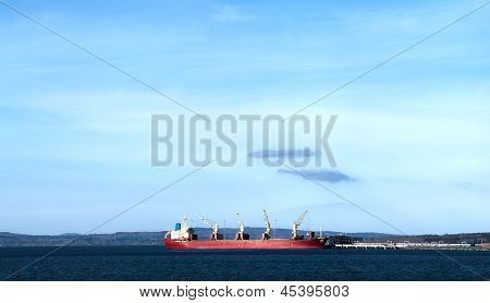 Red Cargo Ship At Port