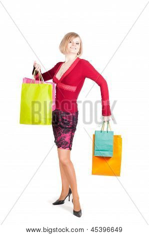 Beautiful woman in red with shopping bags