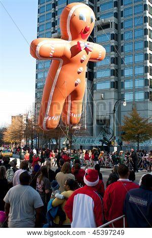 Gingerbread Man Balloon Floats Through Atlanta Christmas Parade