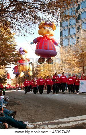 Large Balloon Characters Move Along Route Of Atlanta Christmas Parade