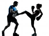 picture of kickboxing  - one caucasian couple man woman personal trainer coach man woman boxing training silhouette studio isolated on white background - JPG