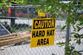 picture of osha  - An OSHA sign is posted at the entrance of a residential construction project - JPG