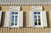 picture of log fence  - Two windows with wooden shutters in the city of Irkutsk - JPG