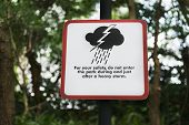 Storm Warning Sign In A Park