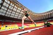 MOSCOW - JUN 11: Athlete running in the stadium on International athletic competition Moscow Challen