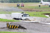 ZHUKOVSKY - JUN 25: White military KAMAZ truck overcome water obstacles pit at demonstrations of tec