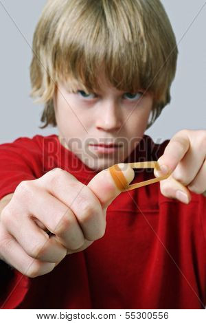Angry Boy aiming a rubber band