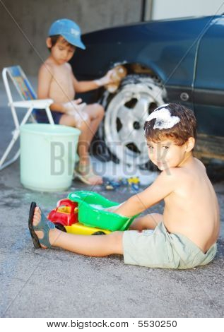 Child Washing Car And Toy Car