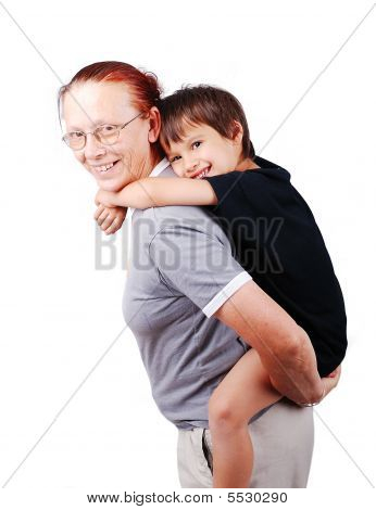 Middle Aged Woman Holding Little Boy On Her Back