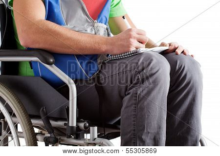 Disabled Student Writing The Notes