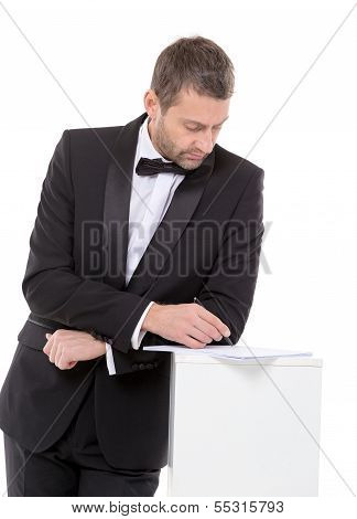 Man In A Bow Tie Completing A Form