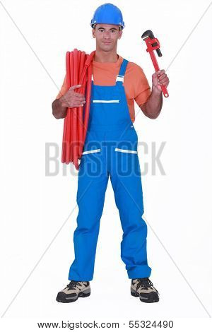Tradesman holding corrugated tubing