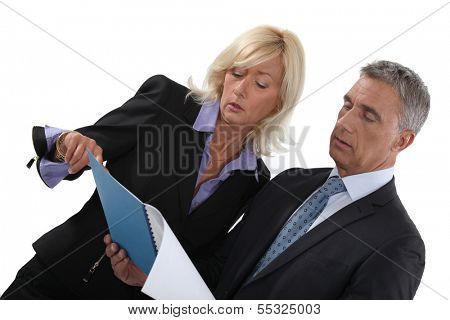 Business people reading a report