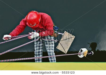 Industrial Worker Hanging On A Rope