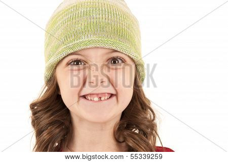 Young Girl In Knit Hat Missing One Tooth
