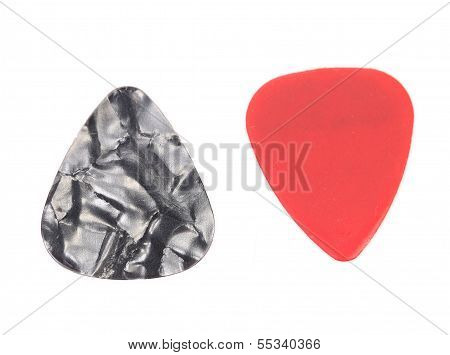 Red and dark plastic guitar plectrums