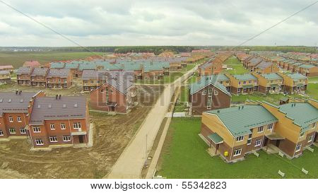 New townhouse village with incomplete cottages. View from unmanned quadrocopter.