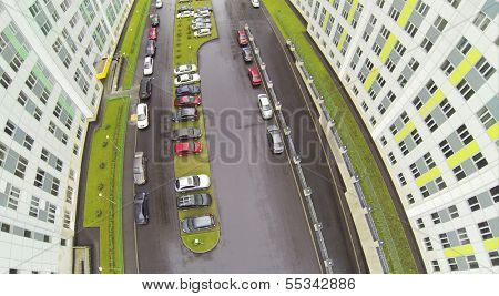 Cars at parking at wet day in residential complex. View from unmanned quadrocopter.
