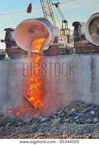 The Molten Slag Is Poured From A Cup On A Railway Platform