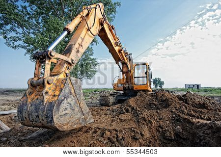 Excavator Digs A Hole