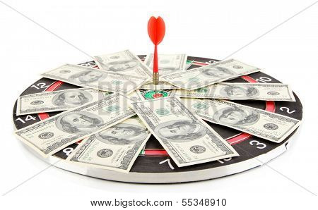 Dart on dartboard and money isolated on white. Concept of success.