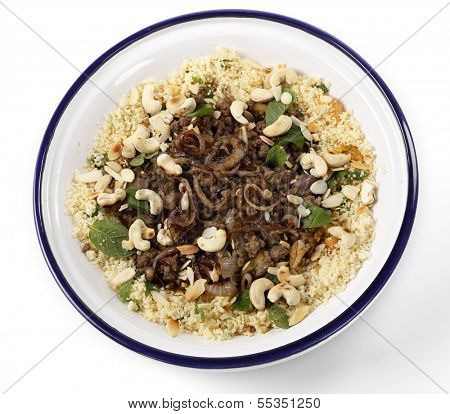 Spicy Moroccan style minced beef served with couscous mixed with chopped herbs and dried apricots, garnished with toasted cashew nuts and almond slivers and topped off with fried onions.