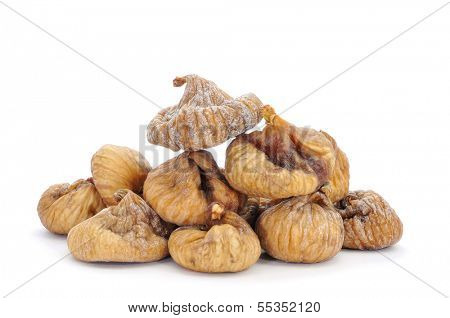 a pile of dried figs on a white background