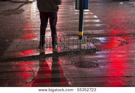 Man Waiting To Cross Street
