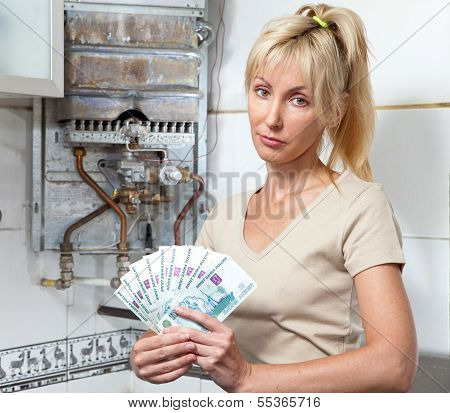 housewife counts up money for repair of a gas water heater