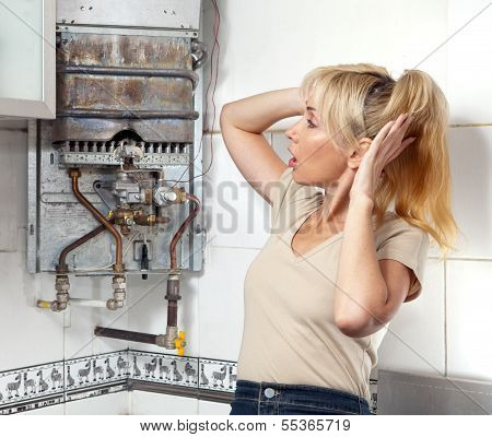 The young woman is upset by that the gas water heater has broken