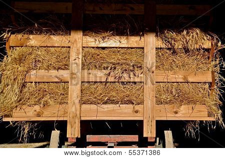 Hay rack loaded with bundles of oats