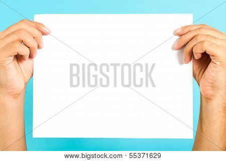 Hands holding a blank message board on blue background
