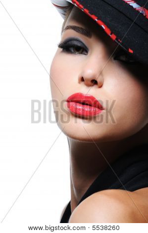 Woman in the fashion hat with bright red lips