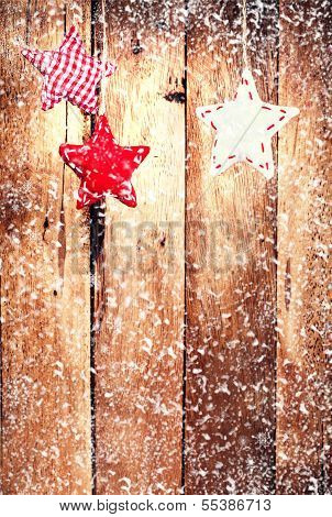 Christmas Ornaments  Over Wooden Wall With Snowflakes. Vintage Christmas Card With White Festive Han