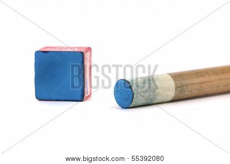 Cue stick with chalk block.